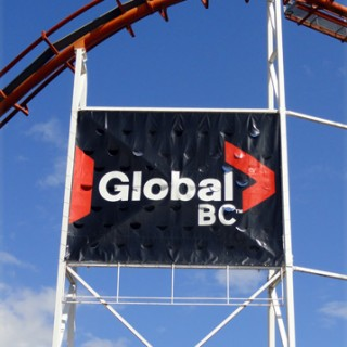 20' x 40' Heavy duty banner for Global BC. We had to have a structural engineer approve the wind load before installation.