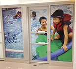 large window sign, window graphics, vinyl on glass